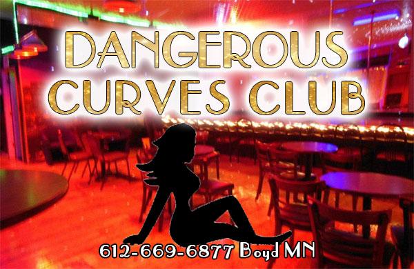 Dangerous Curves Club is an all nude strip club in Boyd Minnesota featuring dance gear by Venus Unveiled